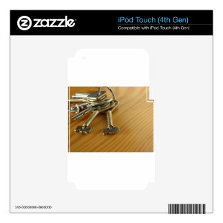 Bunch of worn house keys on wooden table decals for iPod touch 4G