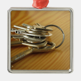 Bunch of worn house keys on wooden table metal ornament