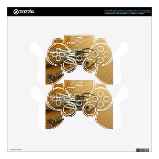 Bunch of worn house keys on wooden table PS3 controller skins
