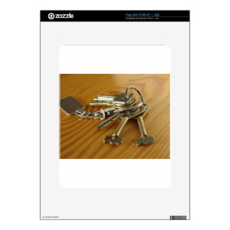 Bunch of worn house keys on wooden table skins for iPad