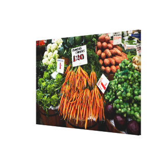 Bunches of carrots and vegetables on market canvas print