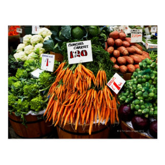 Bunches of carrots and vegetables on market postcard