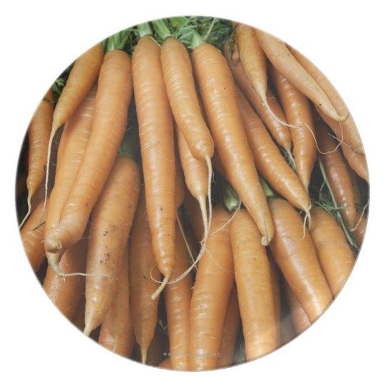 Bunches of carrots, full frame melamine plate