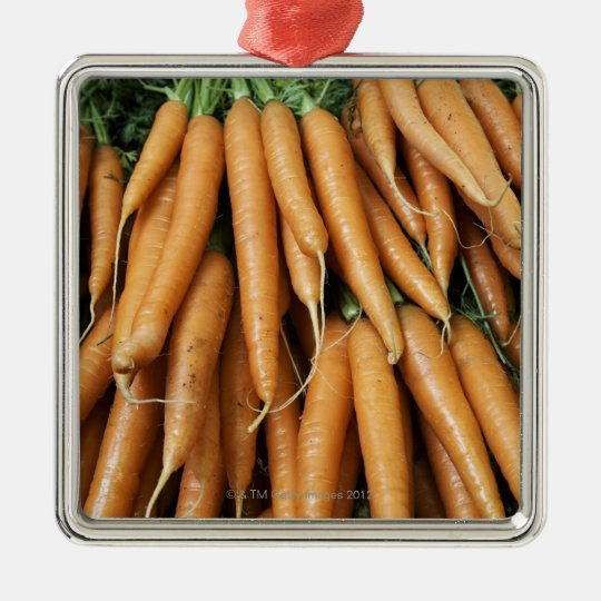 Bunches of carrots, full frame metal ornament