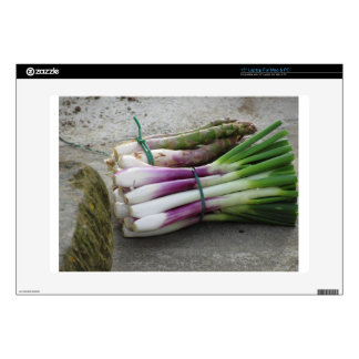 Bunches of fresh onions and asparagus hand picked laptop skin