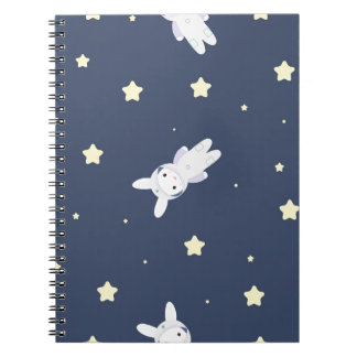 Bunny-astronaut in open space notebook