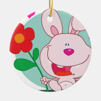 Bunny holds flower ceramic ornament