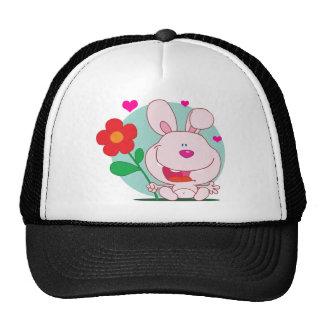 Bunny holds flower hat