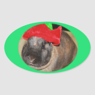 Bunny Rabbit with Santa Hat says Merry Christmas Oval Sticker