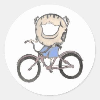 Buñuelo que monta una bicicleta etiqueta
