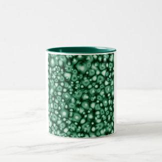 Burbujas abstractas del verde taza de café de dos colores