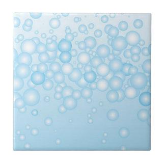 Burbujas azules del baño teja