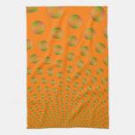 Burbujas en toalla de cocina anaranjada y verde