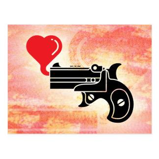 Burbujas que soplan de la pistola del amor tarjetas postales