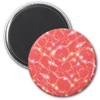 Burbujas translúcidas claras chispeantes en rojo imanes para frigoríficos