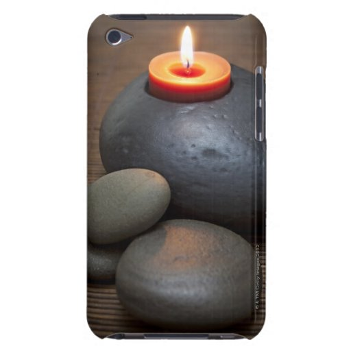Burning candle flame with rocks in tranquil barely there iPod covers