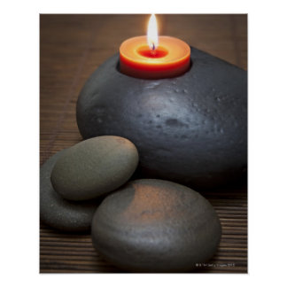 Burning candle flame with rocks in tranquil poster