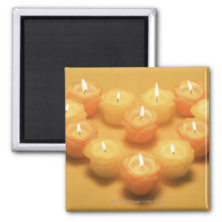 Burning candles arranged in a heart shape 2 inch square magnet