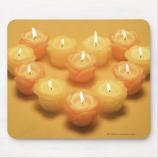 Burning candles arranged in a heart shape mousepad