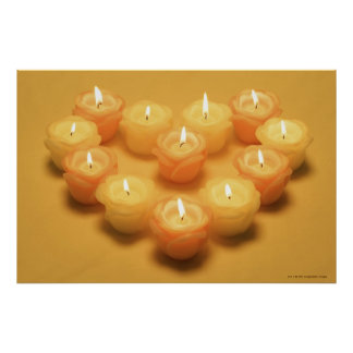 Burning candles arranged in a heart shape poster