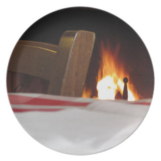 Burning fireplace and old vintage chair plate