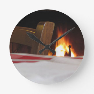 Burning fireplace and old vintage chair round clock