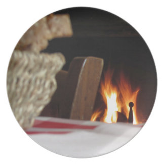 Burning fireplace with basket of bread dinner plate
