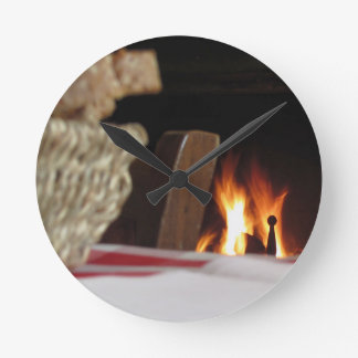 Burning fireplace with basket of bread round clock