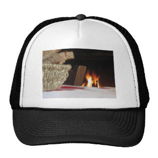 Burning fireplace with basket of bread trucker hat