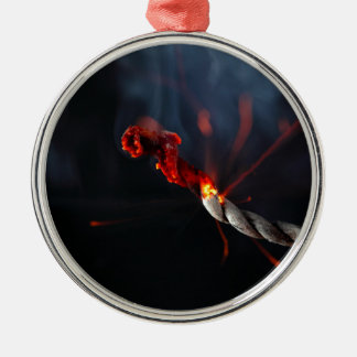 Burning fuse of a firecracker metal ornament