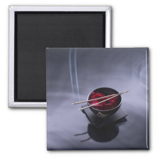 Burning incense on top of bowl of petals 2 inch square magnet