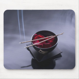 Burning incense on top of bowl of petals mouse pad