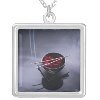 Burning incense on top of bowl of petals square pendant necklace