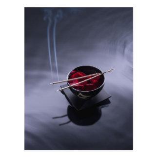 Burning incense on top of bowl of petals postcard