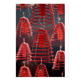 Burning spiral incense coils postcard