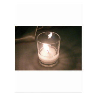 Burning Tea Light Candle with Brown Backdrop Postcard