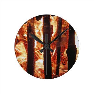 Burning wood round wall clock