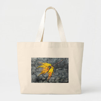 Burnt black wood with yellow leaf large tote bag