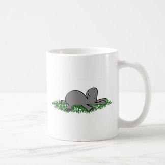 burro napping taza de café