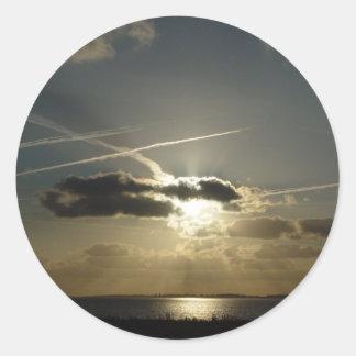 Bursting white sunset classic round sticker