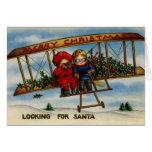 Buscar la tarjeta de Navidad del vintage de Santa
