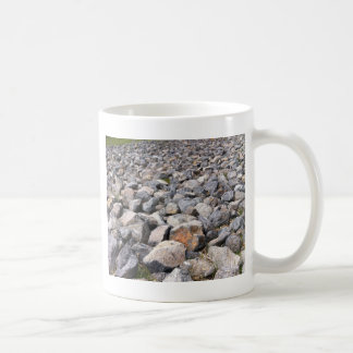 Bush setting of man made rock formation pattern coffee mug