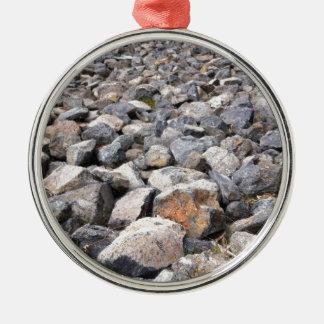 Bush setting of man made rock formation pattern metal ornament