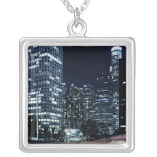 business district with big city lights during silver plated necklace