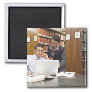 Business people doing research in library 2 inch square magnet