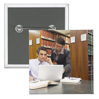 Business people doing research in library button