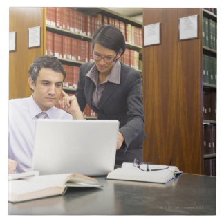 Business people doing research in library ceramic tile
