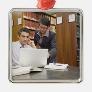 Business people doing research in library metal ornament