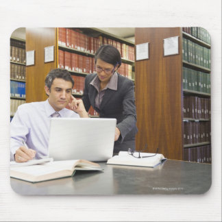 Business people doing research in library mouse pad
