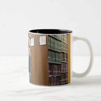 Business people doing research in library Two-Tone coffee mug